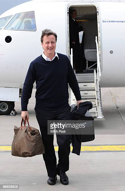 Conservative Party leader David Cameron disembarks his jet at Glasgow Airport during campaigning on May 4 2010 in Glasgow Scotland The General...