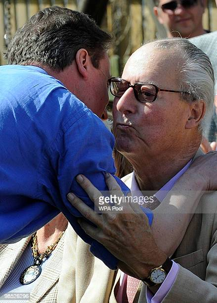 Conservative Party leader David Cameron embraces his father Ian before addressing supporters in the garden of a pubon April 18 Swindon England The...