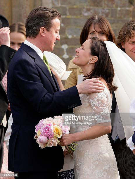 Conservative Party Leader David Cameron embraces his sister Clare following her wedding to Jeremy Fawcus at St Barnabus Church on April 24 2010 in...