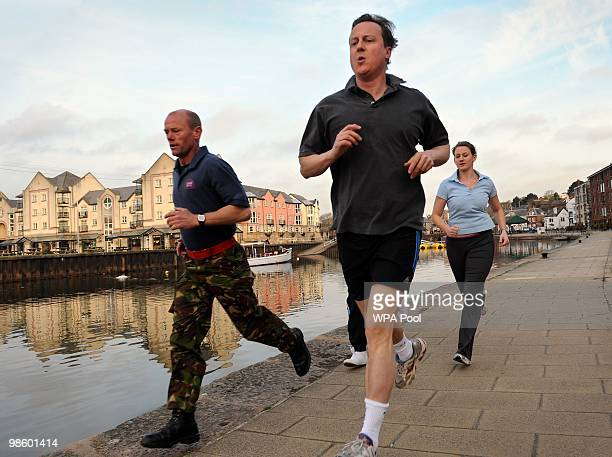 Conservative Party Leader David Cameron jogs jogs with Luke Hardy and Sarah McCarthy along the quayside on April 22 2010 in Exeter in southwest...
