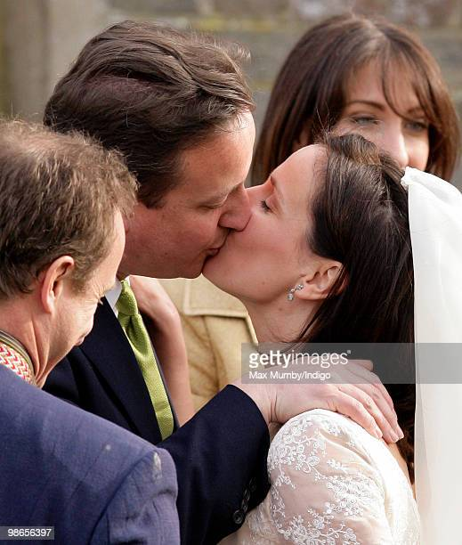 Conservative Party Leader David Cameron kisses his sister Clare following her wedding to Jeremy Fawcus at St Barnabus Church on April 24 2010 in...