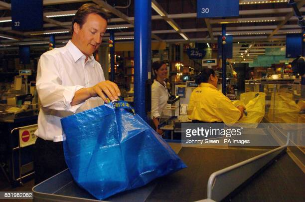 Conservative Party leader David Cameron packs a reusable Big Blue Bag with ecofriendly goods bought from IKEA Wembley in north London to mark World...
