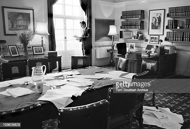 Conservative Party leader David Cameron pictured going through his notes in his office minutes before leaving to 'engage' with Gordon Brown at Prime...
