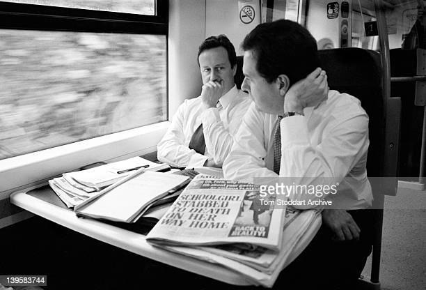 Conservative Party leader David Cameron pictured with his Shadow Foreign Secretary and key advisor George Osbourne during a train journey together to...