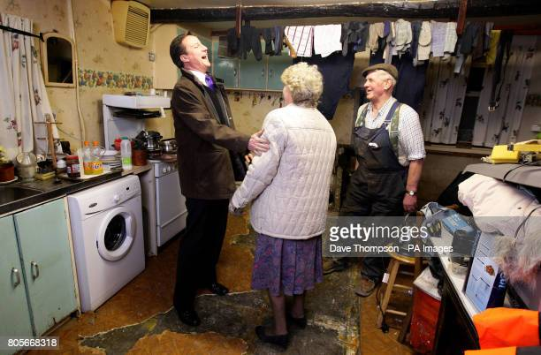 Conservative party leader David Cameron shares a joke with Eileen and Jim Lawson of Lawsons Haulage Ltd, after their home and business were hit by...