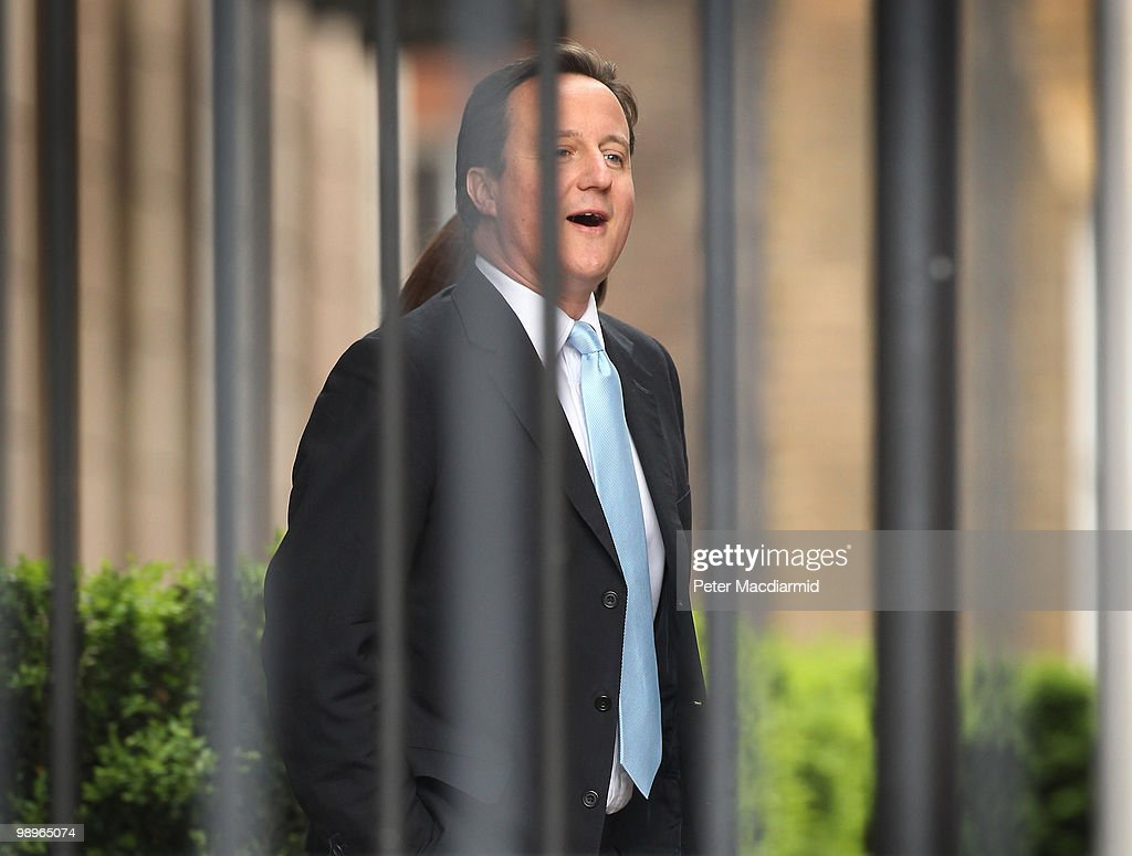 Conservative Party leader David Cameron walks through a fenced off area of Portcullis House at Parliament on May 11, 2010 in London, England. British Prime Minister Gordon Brown has announced that he is to stand down as Prime Minister and Labour Party leader, adding that negotiations with the Liberal Democrats are now taking place to try and form a coalition government. Meanwhile David Cameron said that it is decision time for the Liberal Democrats to choose which party to form a Government with.