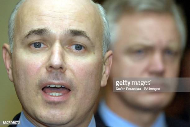 Conservative Party Leader Iain Duncan Smith with party chairman David Davis speaking to the Press at the Imperial Hotel in Blackpool in response to...