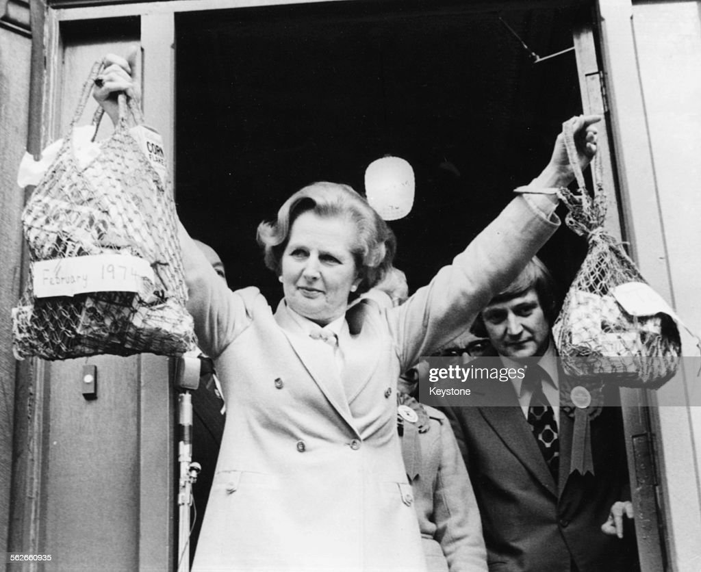 Conservative Party leader Margaret Thatcher holding up two different sized shopping bags, illustrating the difference between the drop in the value of the one pound note under the Labour government, during canvassing for the General Election in Halifax, Yorkshire, April 25th 1979.