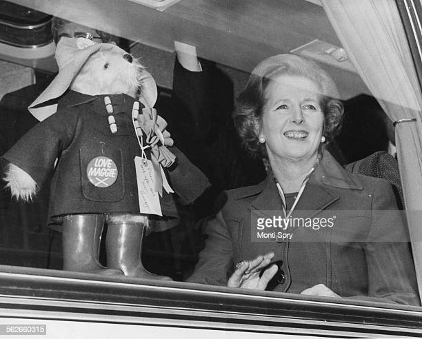Conservative Party leader Margaret Thatcher pictured with a Paddington Bear doll in the window of her coach as she visits Leonora Old People's Home...