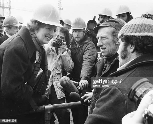 Conservative Party leader Margaret Thatcher talking to a group of men who are working on the new Thames Barrier at Woolwich London February 21st 1979