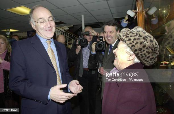 Conservative Party leader Michael Howard talks to his old teacher Miss Jean Pugh at Coleg Sir Gar during a visit of his home town of Llanelli Mr...