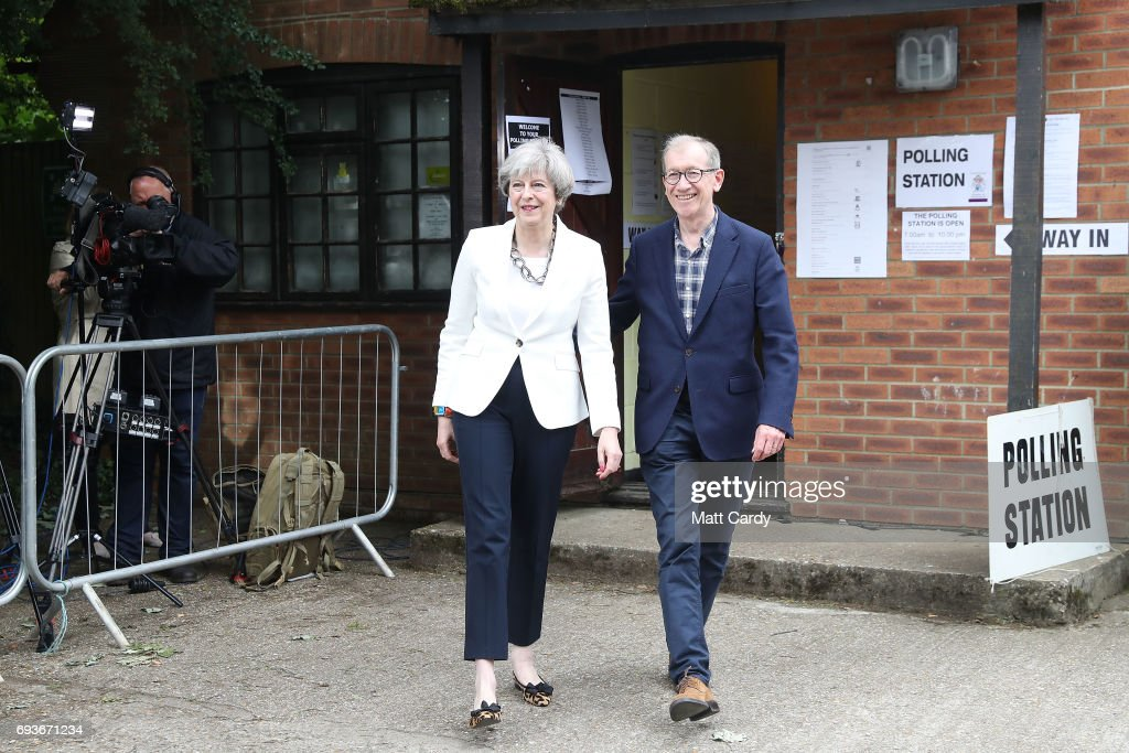 Conservative Party leader Theresa May and husband Philip arrive at a polling station to vote on June 8, 2017 in Maidenhead, England. Polling stations have opened as the nation votes to decide the next UK government in a general election.