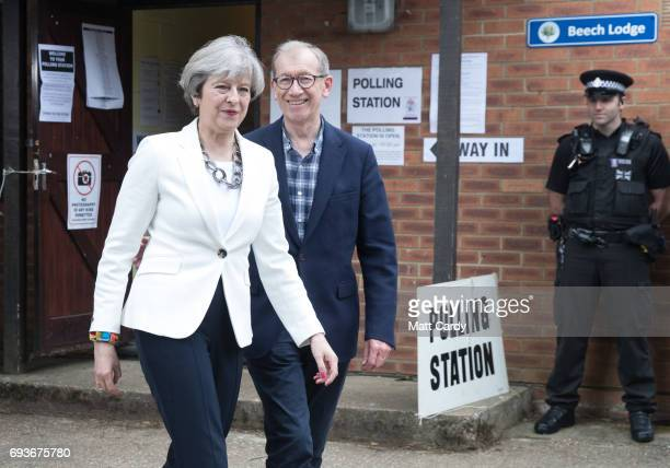 Conservative Party leader Theresa May and husband Philip leave the polling station in Sonning Guide & Scout hut after casting their vote on June 8,...