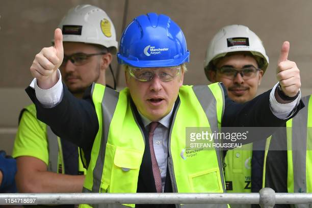 Conservative Party leadership candidate Boris Johnson gestures during a visit to construction work for the expansion of Terminal Two at Manchester...