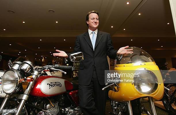 Conservative Party leadership challenger David Cameron views a Norton Commando motorcycle at the National Motor Cycle Museum on the first day of...