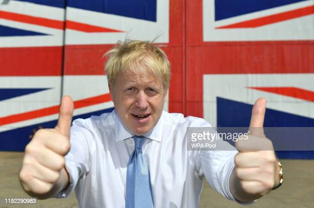 Conservative party leadership contender Boris Johnson poses for a photograph in front of a Union Jack on a wall at the Wight Shipyard Company at...