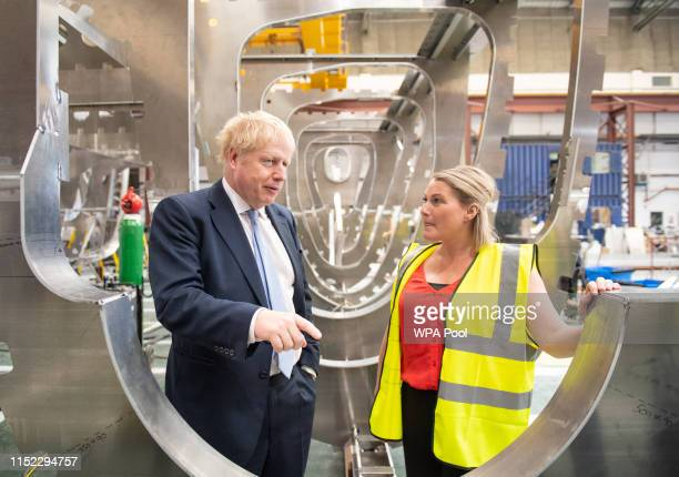 Conservative party leadership contender Boris Johnson shown around a boat under construction at the Wight Shipyard Company at Venture Quay during a...