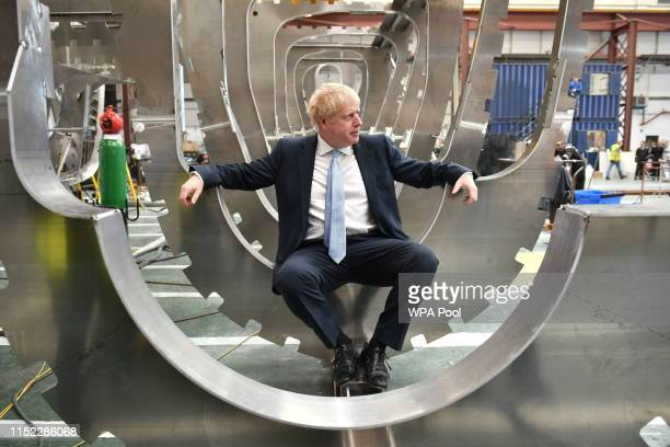 Conservative party leadership contender Boris Johnson sits in a boat under construction at the Venture Quay boatyard during a visit to the Isle of...