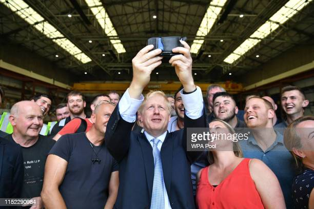 Conservative party leadership contender Boris Johnson takes a selfie with workers at the Wight Shipyard Company at Venture Quay during a visit to the...