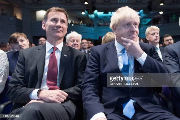 Conservative Party leadership contenders Boris Johnson and Jeremy Hunt sit together at an event to announce the winner of the party's leadership...