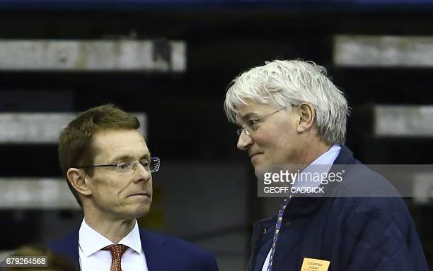 Conservative Party mayoral candidate Andy Street speaks to British Conservative Party politician Andrew Mitchell during the second count of the West...
