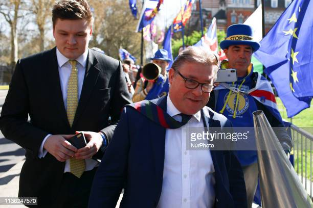 Conservative Party MP and prominent Brexiteer Mark Francois speaks to antiBrexit activist Steve Bray outside the Houses of Parliament in London...