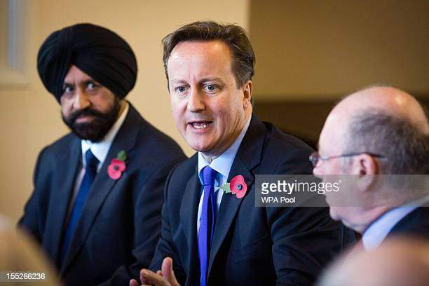 Conservative Party PCC candidate Jas Parmar Prime Minister David Cameron and local MP Alistair Burt are seen during their visit to The Women's...