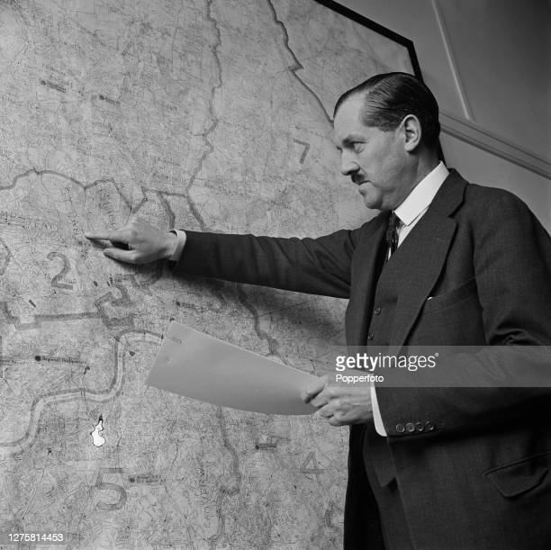 Conservative Party politician Captain Euan Wallace , London Regional Commissioner and former Minister of Transport, points to a map of London during...