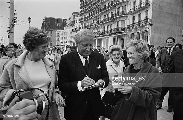 Conservative Party politician Edward Heath signs autographs outside the Conservative Party Conference in Brighton Sussex 8th October 1969