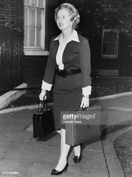 Conservative Party politician Margaret Thatcher holding two briefcases as she arrives at 10 Downing Street for a Cabinet meeting London November 3rd...