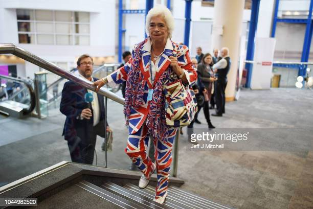 Conservative Party supporter Tessa Miller wearing a Union Jack suit during the final day of the Conservative Party Conference on October 3 2018 in...