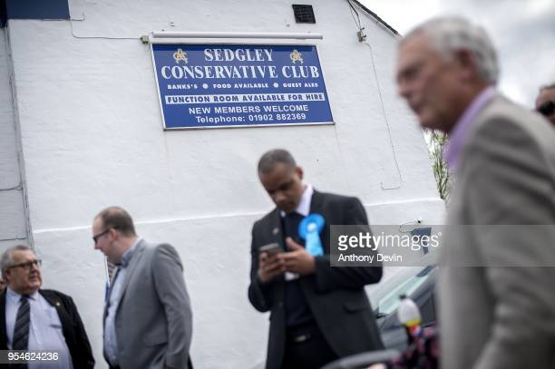 Conservative Party supporters wait to greet Prime Minister Theresa May at Sedgley Conservative Club in Dudley West Midlands on May 4 2018 in Dudley...