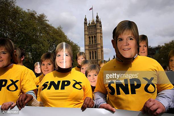 Conservative Party supporters wear Nicola Sturgeon masks during a photocall in Victoria Tower Gardens on May 1 2015 in London England The stunt was...