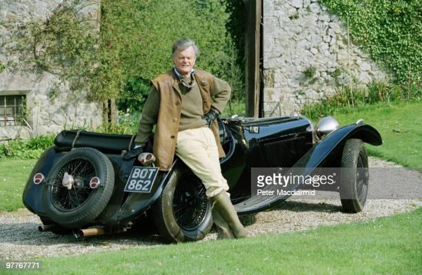 Conservative politician Alan Clark with his Jaguar SS100 sports car at his home at Saltwood Castle, Kent, 16th April 1994.