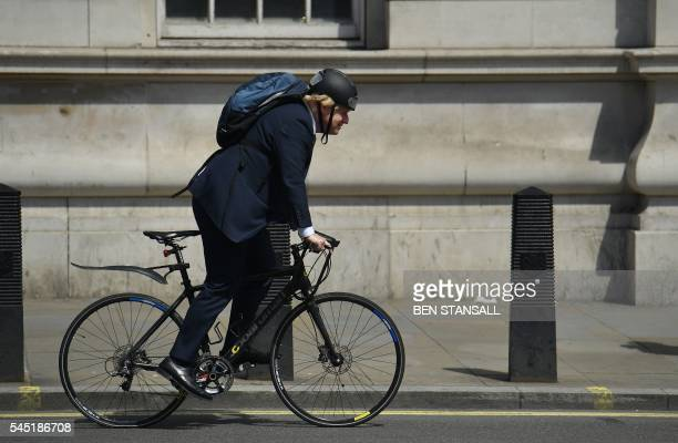 Conservative politician Boris Johnson cycles in central London on July 6, 2016. / The erroneous mention[s] appearing in the metadata of this photo by...