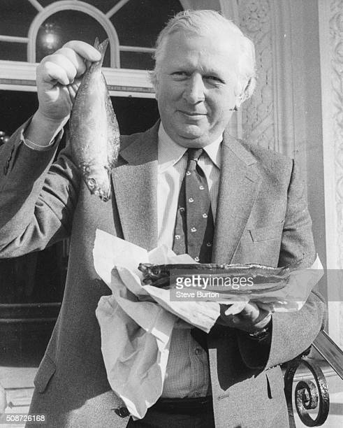 Conservative politician Jim Prior the Shadow Employment Secretary holding up a kipper which he was presented with for his 51st birthday at the Tory...