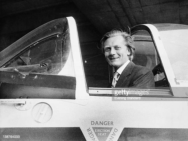 Conservative politician Michael Heseltine Minister for Aerospace sitting in a cockpit