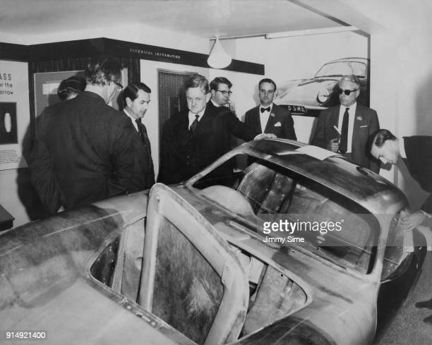 Conservative politician Quintin Hogg 2nd Viscount Hailsham the Minister for Science examines the fibreglass reinforced body of a Lotus Elite Type 14...
