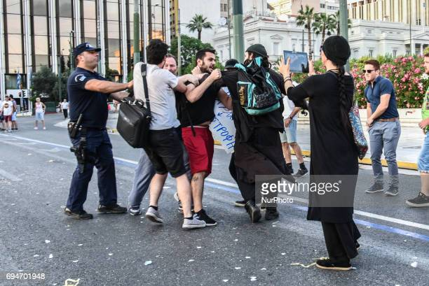 Conservative priest and his supporters attacking a gay demonstrator in Athens Greece on June 10 2017