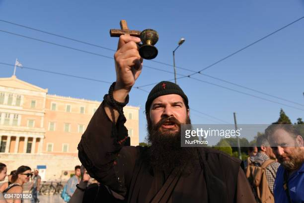 Conservative priest and his supporters condemning and swearing against gays in Athens Greece on June 10 2017