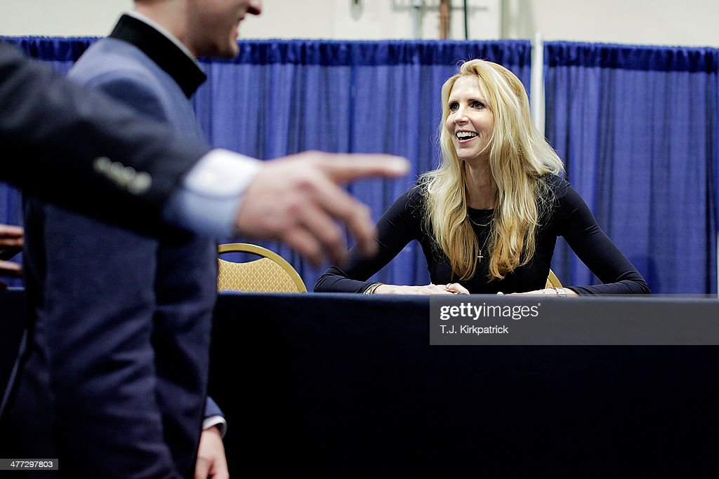 Conservative pundit and author Ann Coulter signs books