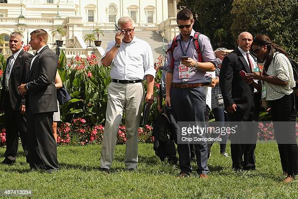 Conservative pundit Glenn Beck is surrounded by staff and private security guards as he prepares to take the stage during a rally against the Iran...