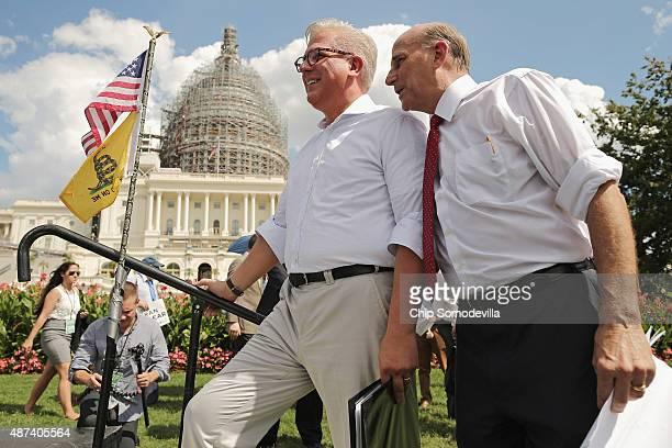 Conservative pundit Glenn Beck listens to Rep. Louie Gohmert before taking the stage during a rally against the Iran nuclear deal on the West Lawn of...