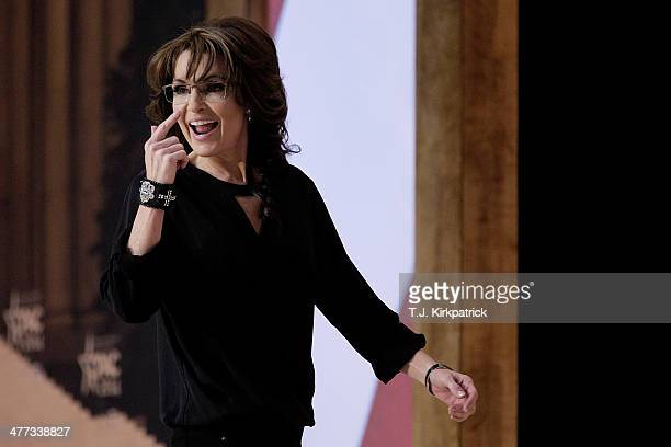 Conservative pundit television personality and former vice presidential candidate Sarah Palin gestures as she leaves the stage during the 41st annual...