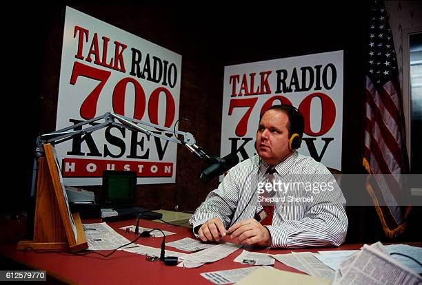 Conservative radio host Rush Limbaugh sits at his desk at Talk Radio 700 KSEV during the Republican National Convention in Houston