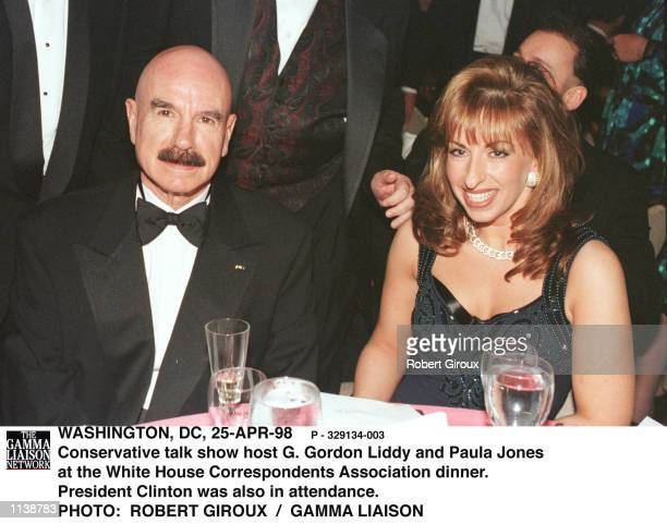 Conservative radio talk show host and Watergate burglar G Gordon Liddy and Clinton accuser Paula Jones sit together 25Apr98 at the White House...