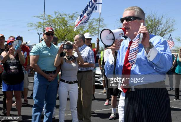 Conservative radio talk show host Wayne Allyn Root speaks to supporters before hosting a protest caravan on the Las Vegas Strip to demand the...