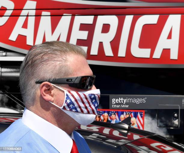Conservative radio talk show host Wayne Allyn Root stands in front of a bus with Trump/Pence signage before hosting a protest caravan on the Las...