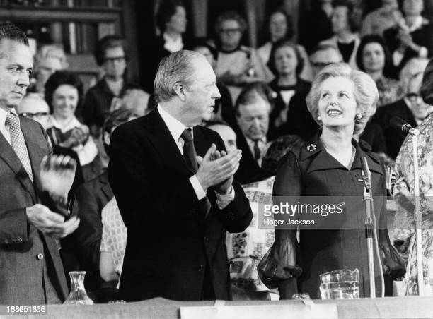 Conservative Shadow Cabinet members Keith Joseph and Airey Neave applaud Conservative Party leader Margaret Thatcher after a speech to the...