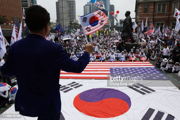 Conservative South Korean demonstrators participate in a rally welcoming US President Donald Trump's visit to the country on June 29 2019 in Seoul...